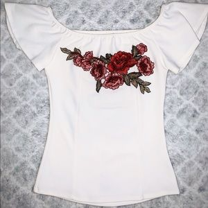White shirt with roses